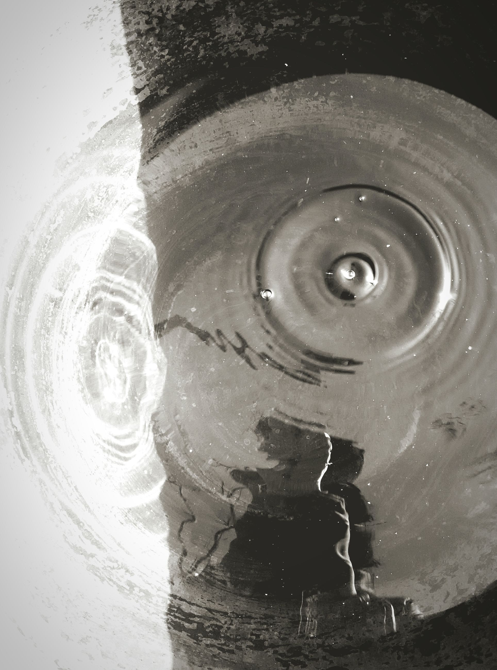 water, reflection, close-up, high angle view, waterfront, wet, rippled, drop, no people, old, day, puddle, metal, outdoors, circle, purity, fountain, part of, built structure