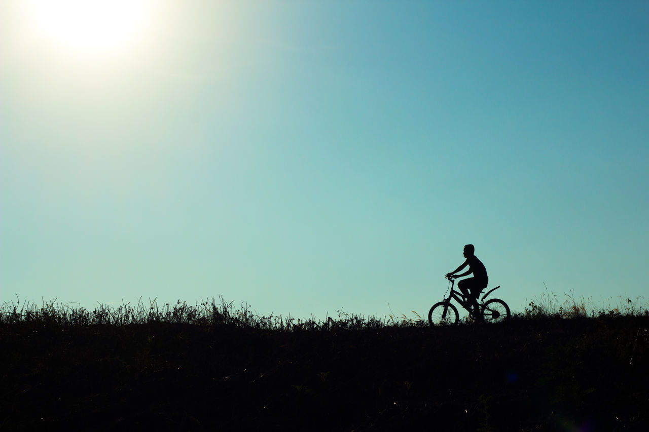 Adult Adults Only Bicycle Cycling Motorcycle Racing Mountain Bike Nature Night One Man Only One Person Only Men Outdoors People Silhouette Sky Speed Sunset Transportation