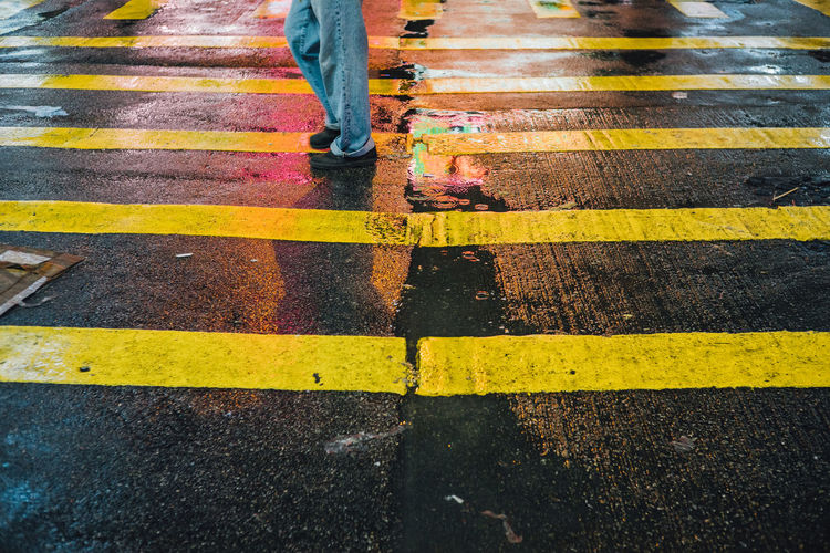 Asphalt City Life Day Diminishing Perspective Elevated View Lifestyles Outdoors Rain Drops Raining Rainy Day Rainy Days Road Road Marking Street Stride By Strideby The Way Forward Unrecognizable Person Vanishing Point Yellow The Street Photographer - 2016 EyeEm Awards