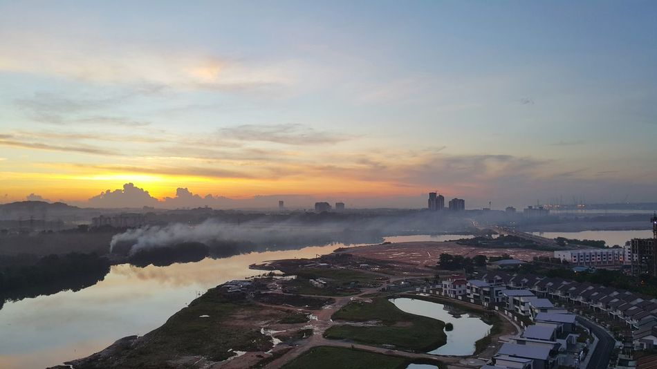 Water Sunset Reflection Lake Outdoors Landscape Scenics Tree Sky Nature Urban Skyline Beauty In Nature No People Day Johor Bahru Sky Malaysia Johor Bahru Adapted To The City