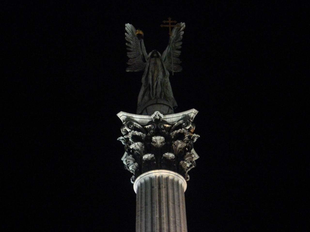 statue, sculpture, no people, night, low angle view, outdoors, black background, architecture, sky