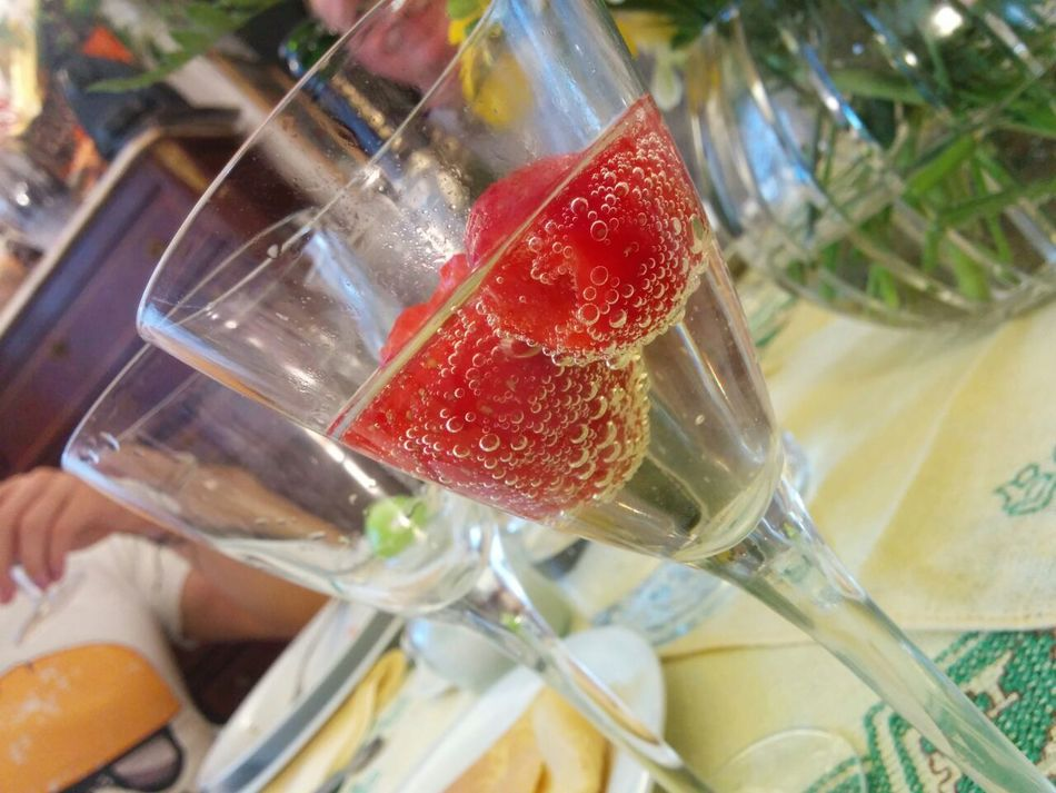 Strawberries floating in champagne. Bubbles Celebrate Celebration Champagne Close-up Drink Drinking Drinking Glass Drinking Glasses Easter Family Food Food And Drink Freshness Friends Fruit Glass Indoors  NYE Real People Red Refreshment Strawberries Water Wine
