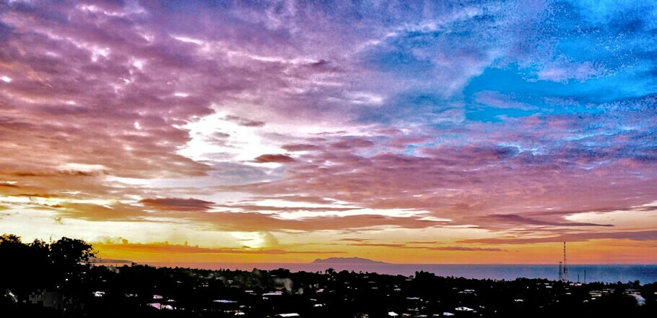 Above Honiara capital city, overlooking Savo Island. Honiara, Solomon Islands Cloud - Sky Sky Scenics Tranquility Blue Nature Dramatic Sky Outdoors Tranquil Scene Multi Colored Residential District
