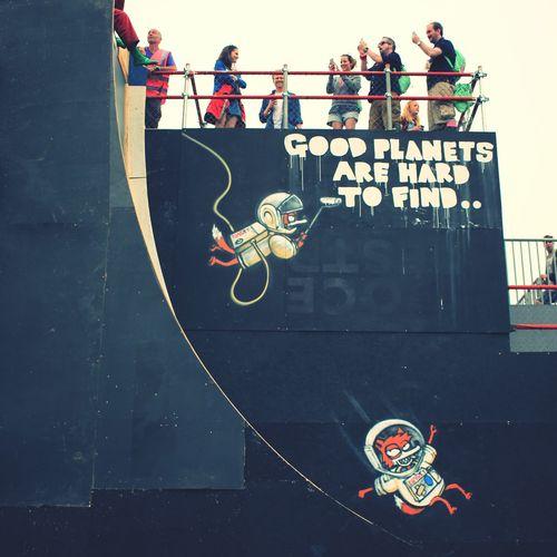 Glastonbury Music Festival Greenpeace Slide Cartoon Astronaut Planet at Glastonbury Festival