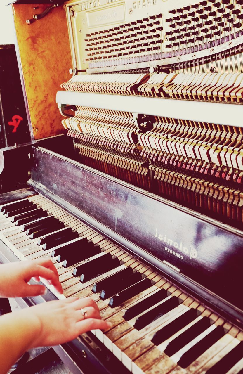 music, piano, musical instrument, piano key, human hand, pianist, indoors, playing, human body part, musician, real people, one person, arts culture and entertainment, close-up, musical note, classical music, keyboard, day, people