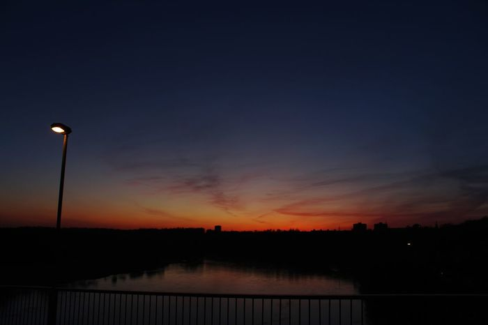 Reflection Sunset Outdoors No People Lake Silhouette Water Sky Nature Scenics Night Beauty In Nature Tree Street Lamp Winter Cold Night Time River Brige Over River Beautiful Sunset♥♥Good Evening EyeEm EyeEmNewHere