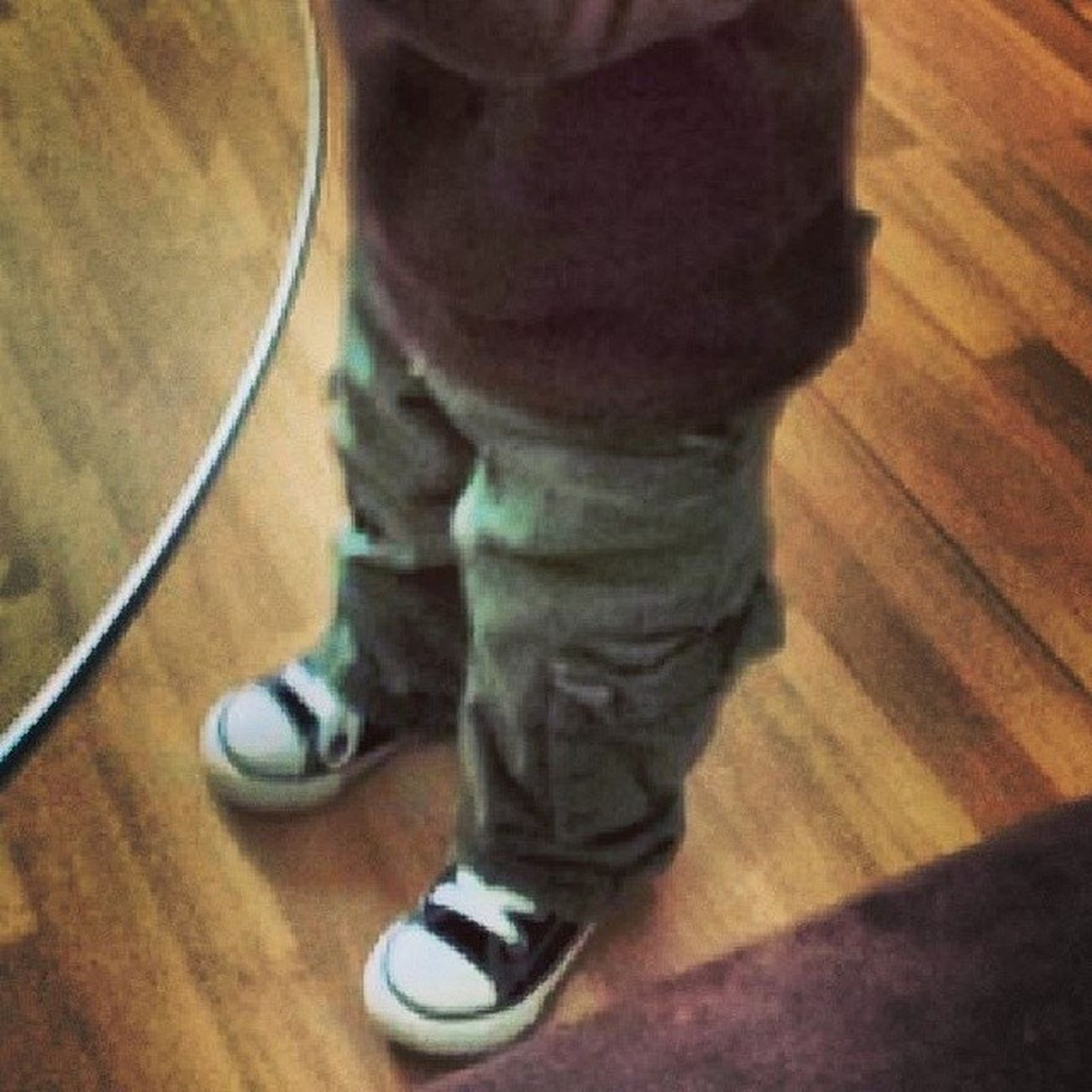 His little feet are going to take him far in life. Rockinhisconverses Iboughthim Tinytoes