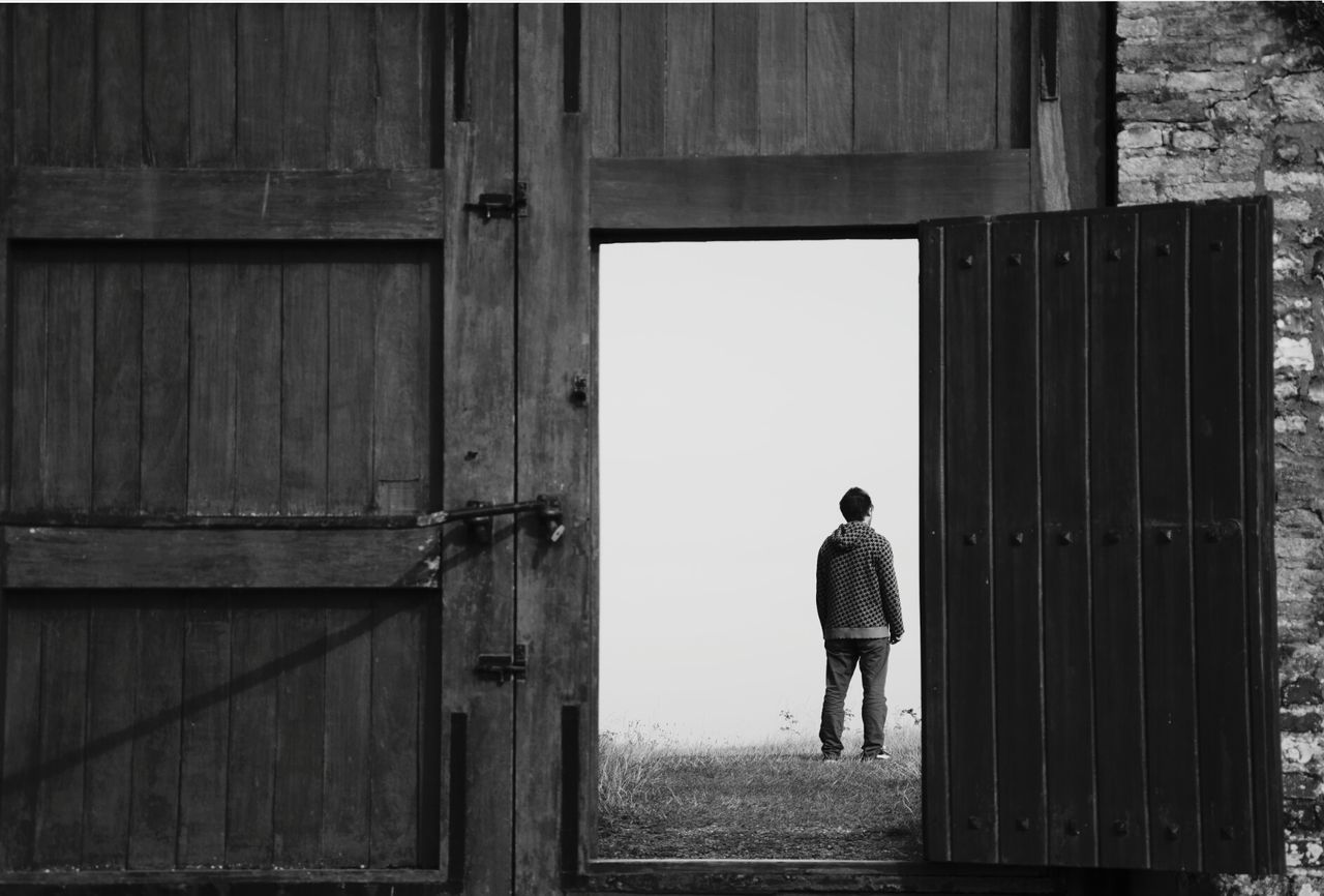 Wooden Door Man Alone Blackandwhite Normandie, France Modern Western The Following Door Open Staring Loneliness What's Next Back Turned Timeless Fine Art Photography Adapted To The City