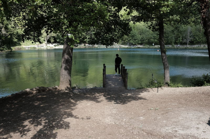 Beauty In Nature Day Growth Lake Nature One Person Outdoors People Real People Sinizzo Standing Tree Water