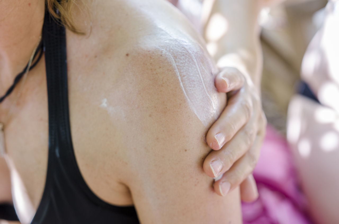 person is applying sunscreen a one woman Applying sunscreen Holiday Sunscreen Vaction Summer human body part human hand human skin midsection people protection skin summer