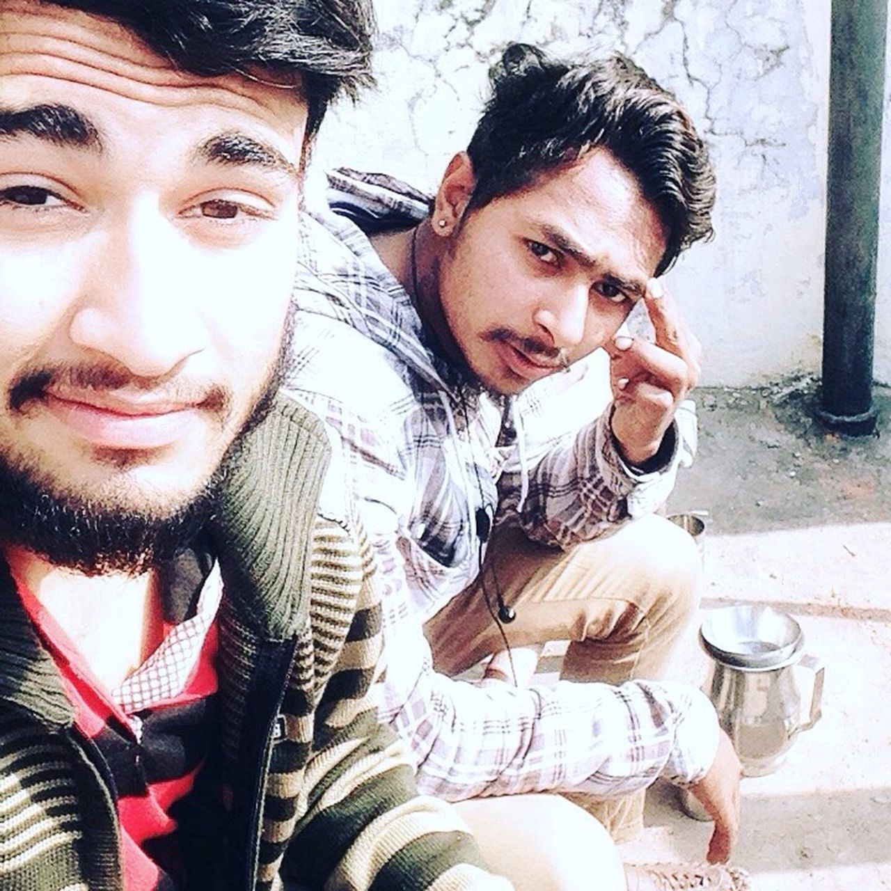 two people, real people, togetherness, young men, young adult, lifestyles, front view, looking at camera, casual clothing, leisure activity, mid adult men, happiness, portrait, smiling, sitting, day, young women, bonding, friendship, drink, men, indoors, close-up, adults only, adult, people