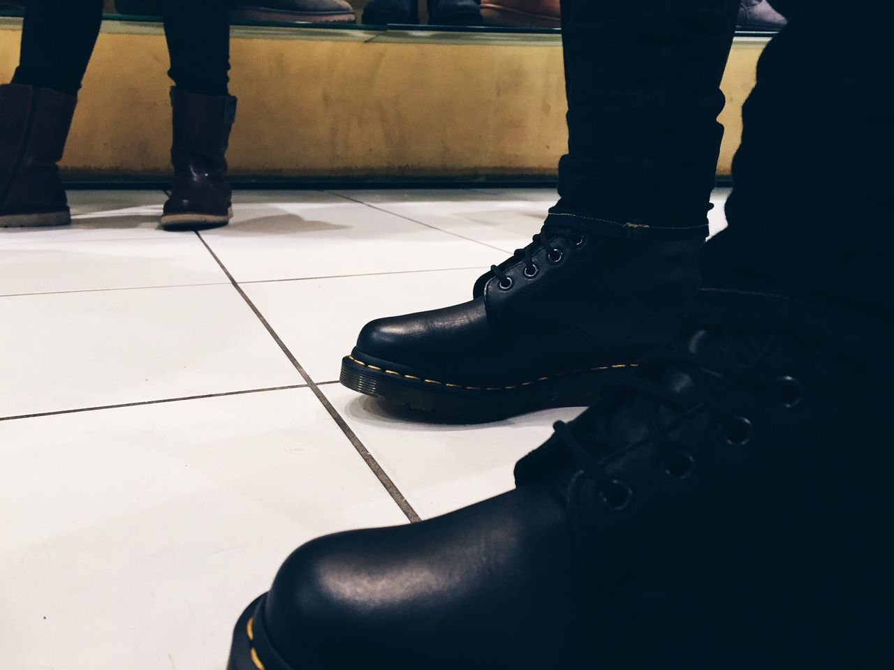 low section, indoors, shoe, human leg, real people, standing, two people, human body part, men, day, lifestyles, close-up, people