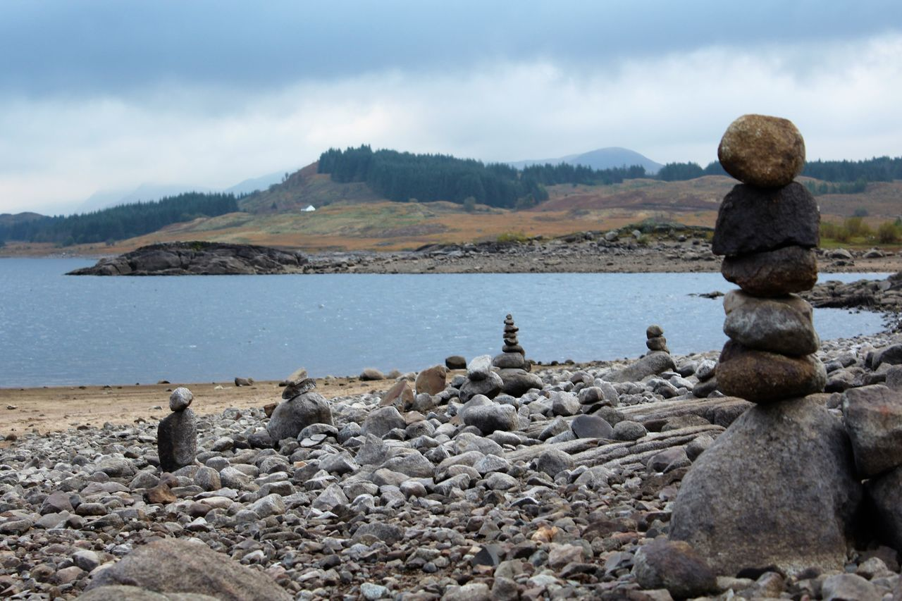 Beach Beauty In Nature Cloud - Sky Day Loch Doon Mountain Nature No People Outdoors Pebble Rock - Object Scenics Sea Sky Standing Stones Stone Piles Tranquil Scene Tranquility Water