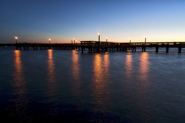 Beauty In Nature Blue Built Structure Calm Dark Illuminated Nature Night No People Ocean Orange Color Outdoors Pier Reflection Rippled Scenics Sky Sunset Tranquil Scene Tranquility Travel Destinations Water Solomon's Boat Ramp And Fishing Pier Solomons, MD