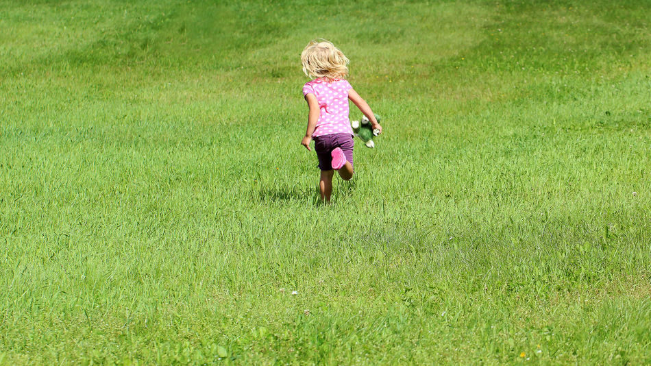 """The little girl runs to her mother and shouts, """"on the way mom"""" Casual Clothing Cudley Toys Day Eyeemphoto EyeEm Gallery Field Full Length Fun Girl Grass Grassy Green Color Growth Kid Kidsphotography Landscape Leisure Activity Lifestyles Nature On The Way Outdoors The Magic Mission Running Human Color Palette"""