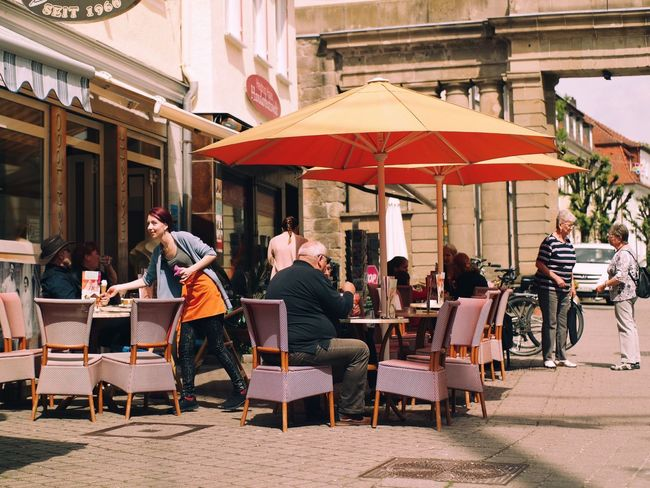 Leisure in the sun... City Life Tranquil Scene Street Photography My Favorite Photo Town What's On The Roll Enjoying Life Natural Light Vscocam Found On The Roll Leisure Activity Travel Destinations Tourist Attraction  Travel Outdoor Photography Germany🇩🇪 Hanging Out City Street Scenery Shots Selective Focus Traveling Tourism EyeEm Best Shots Group Of People Architecture