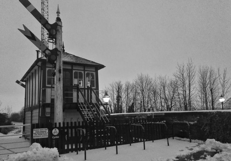 Railway Signals Railway Signals Settle Blackandwhite Snow ❄ Day Outdoors Built Structure Architecture Tree No People Winter Nature Sky Building Exterior