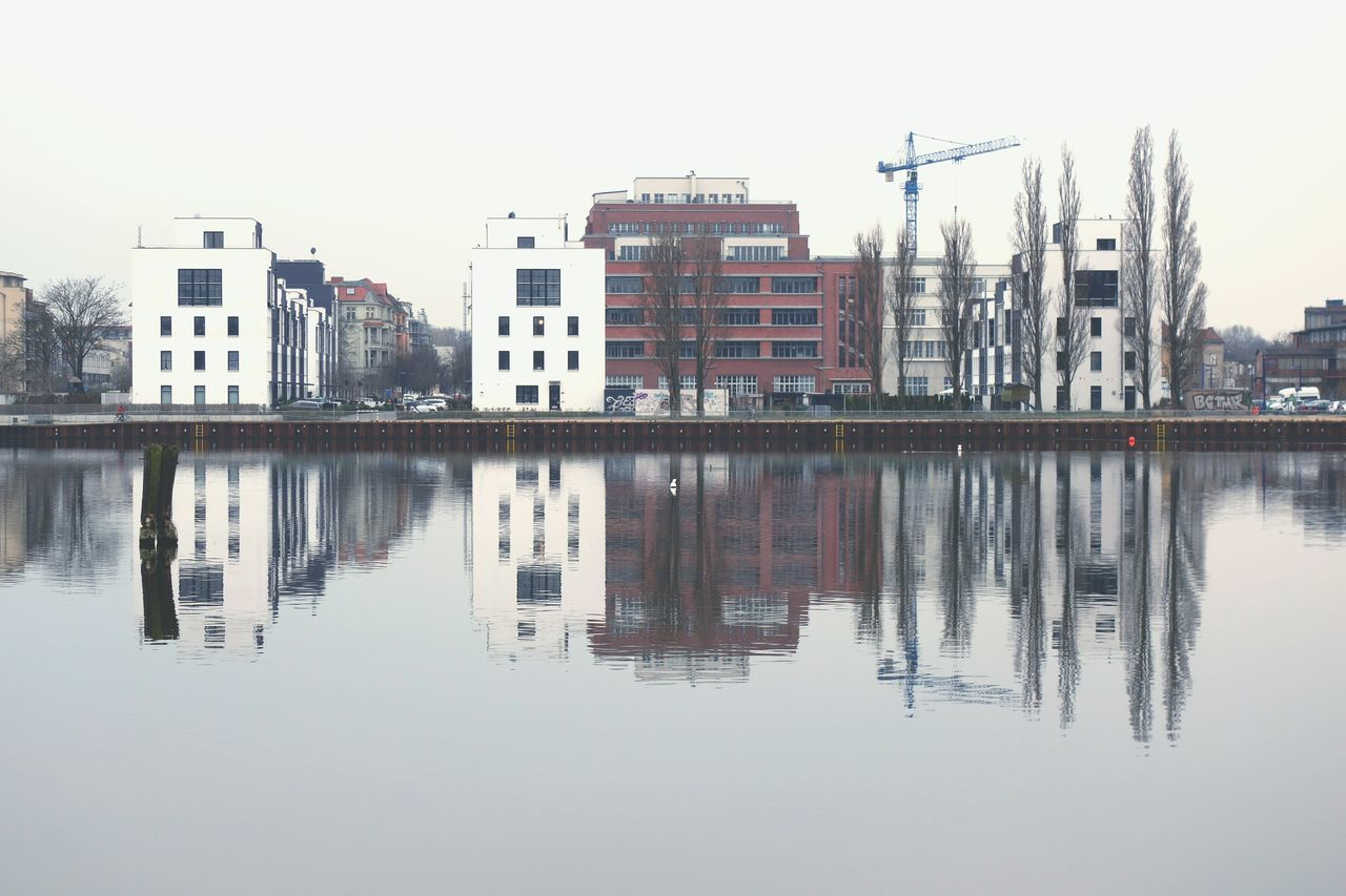 Water Reflection City Lake Outdoors Urban Skyline No People Sky My Fuckin Berlin Water Reflections Architecture Modern Architecture Shootermag Eye4photography  Symmetrical Tree EyeEm Masterclass Cold Temperature