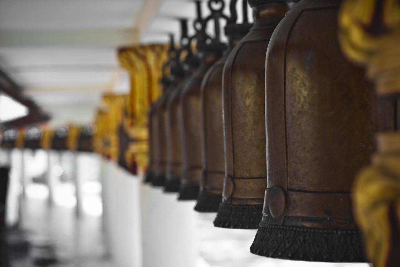 in a row, selective focus, no people, metal, close-up, focus on foreground, indoors, day