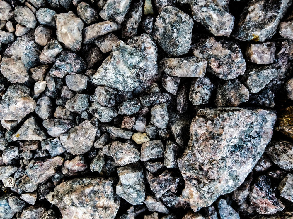 Full Frame Backgrounds No People Pattern Textured  Large Group Of Objects Outdoors Nature Day Close-up Rocks Rocky Rock Texturestyles Texture Background Patterns In Nature Pattern Design Design Rock Background Rough Texture Rough Sharp River Rocks Rock Patterns EyeEmNewHere