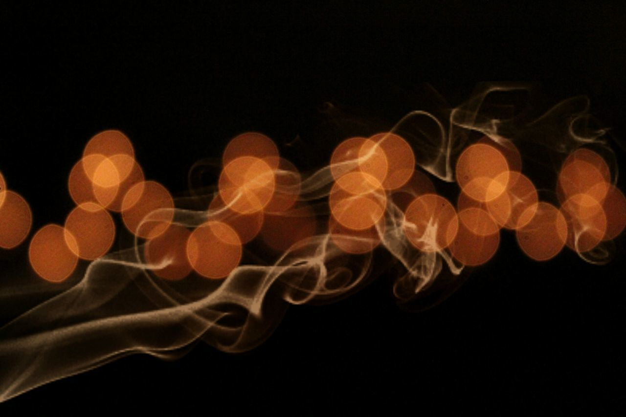 black background, studio shot, night, illuminated, no people, pattern, close-up, outdoors