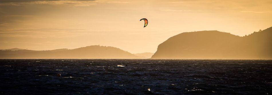 EyeEmNewHere Beach Water Sunset Beauty In Nature Sea And Sky Senic View Sea Seascape Kitesurfing Kite