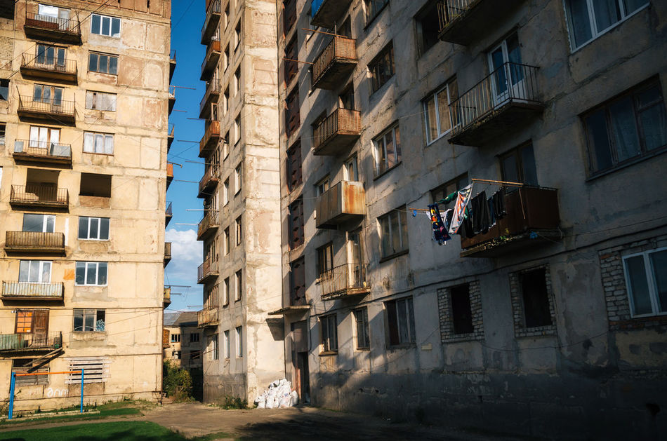Laundry on the balcony of one of the few apartments whose residents did not leave the working area, Chiatura, Georgia Abondoned Apartment Architecture Building Exterior Built Structure Chiatura Deserted Georgia Laundry Light And Shadow Neglected No People Ussr