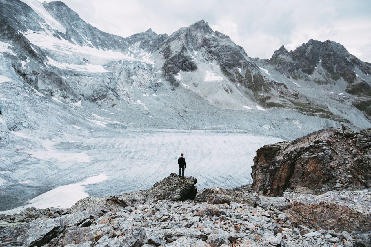 togetherness mountain snow Nature beauty in Nature adventure scenics Hiking rock - object one person Winter outdoors mountain range landscape cold temperature leisure activity sky real people Standing full length one man only switzerland glacier alps cold