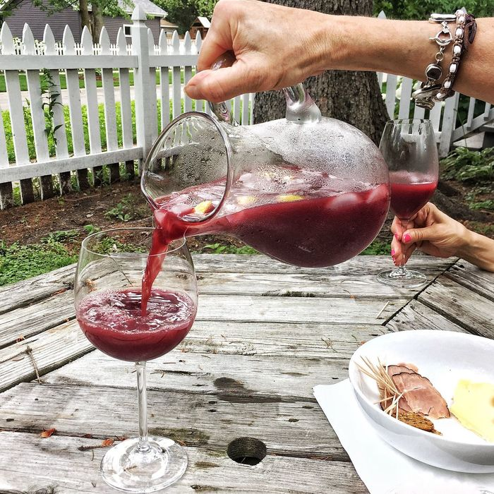 Winenot Wineglass Food And Drink Drink Human Hand Outdoors Wine Alcohol Lifestyles Red People Sangria Sangria Time Sangrias Backyard Garden Backyard Whitepicketfence Wine Not