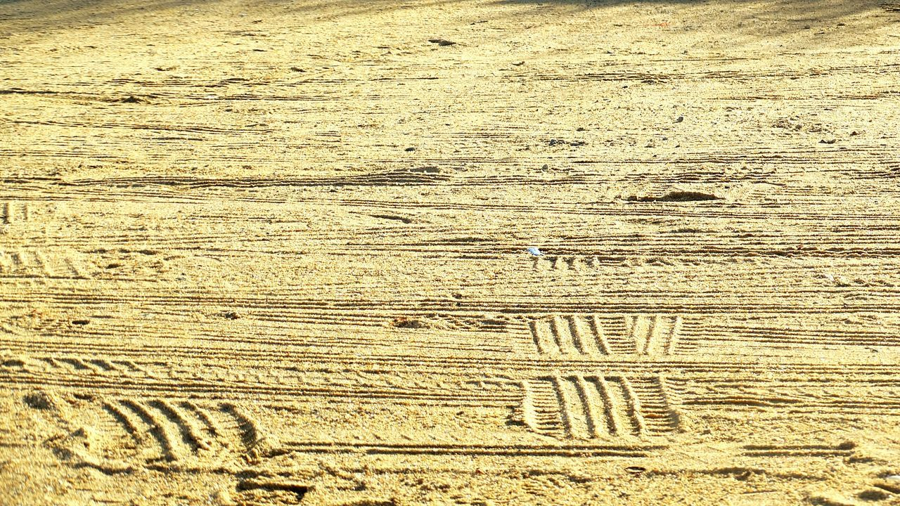 Tyre tracks. Sand Beach Tranquility Day Outdoors No People Tyre Tread Tread Marks Tread Pattern Parking Cars Shadows Patterns & Textures Patterns In The Sand
