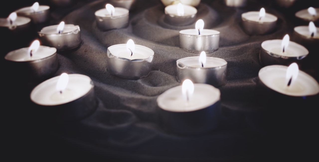 Tealights in sand Candle Flame Indoors  Close-up No People Burning Tea Light Candlelight Candlelights Sand Mourning Mourning Ritual