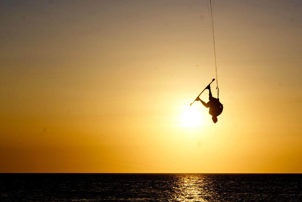 Kit Adult Adults Only Adventure Awe Beauty In Nature Day Full Length Gold Colored Horizon Over Water Kite Kitesurfing Nature One Man Only One Person Only Men Outdoors Patience People Sea Silhouette Sun Sunset Tranquility Vacations Water