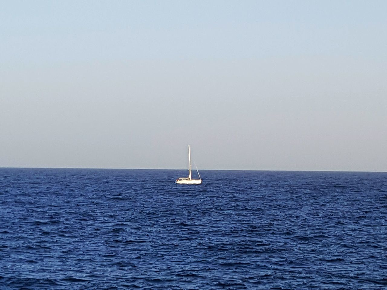 Nautical Vessel Sailing Sea Water Sailboat Transportation Sailing Ship Horizon Over Water Outdoors Sky Yachting Yacht White Sailing Ship One Single Sailboat Sailing Boat Blue Sea And White Sailboat