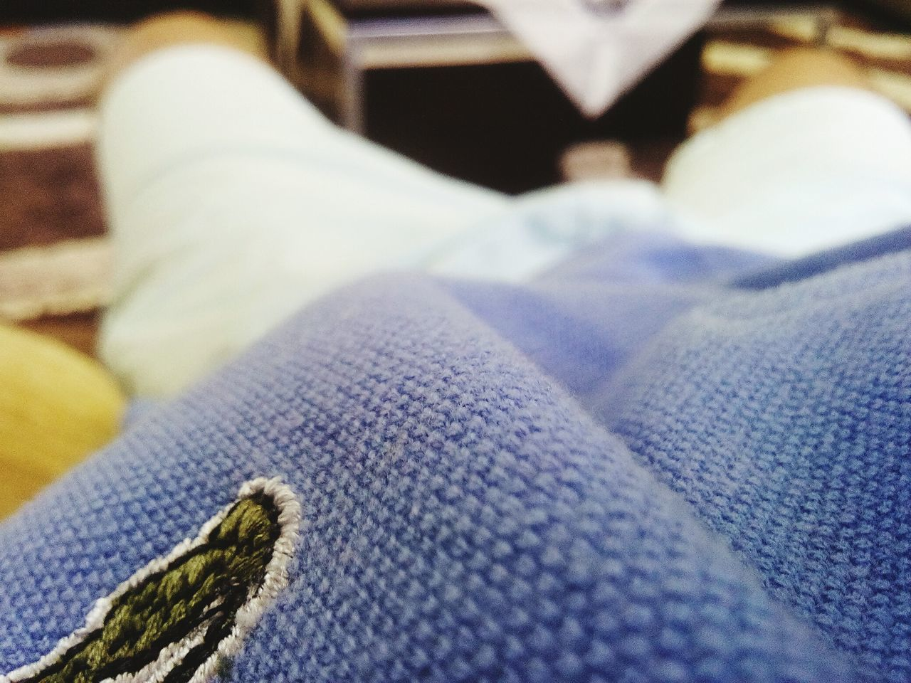 human leg, jeans, low section, shoe, fashion, human body part, real people, close-up, one person, sock, indoors, blue, leisure activity, lifestyles, wool, relaxation, day, warm clothing, people
