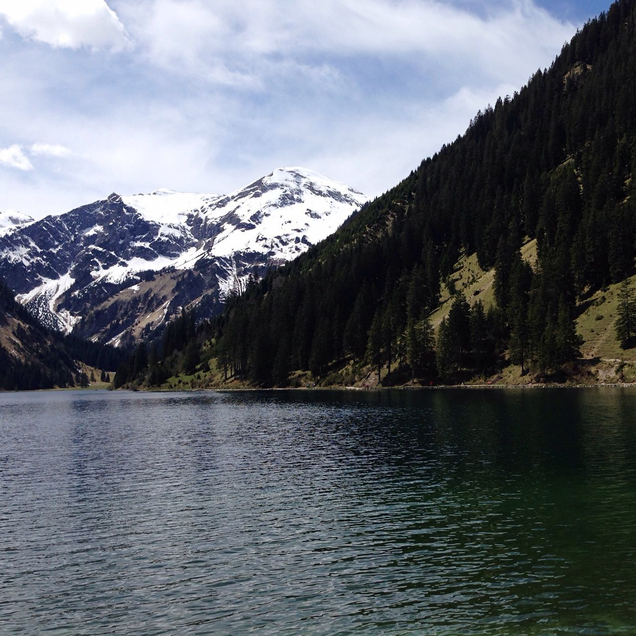 Scenic lake an mountain view; Vilsalpsee Tannheimer Tal Mountain Beauty In Nature Nature Scenics Tranquil Scene Sky Snow Lake Water Outdoors Holiday Travel Tirol  Vilsalpsee Tannheimer Tal Spring Outdoor Landscape Light Life Colors Austria Nature Alps Nautical Vessel The Great Outdoors - 2017 EyeEm Awards