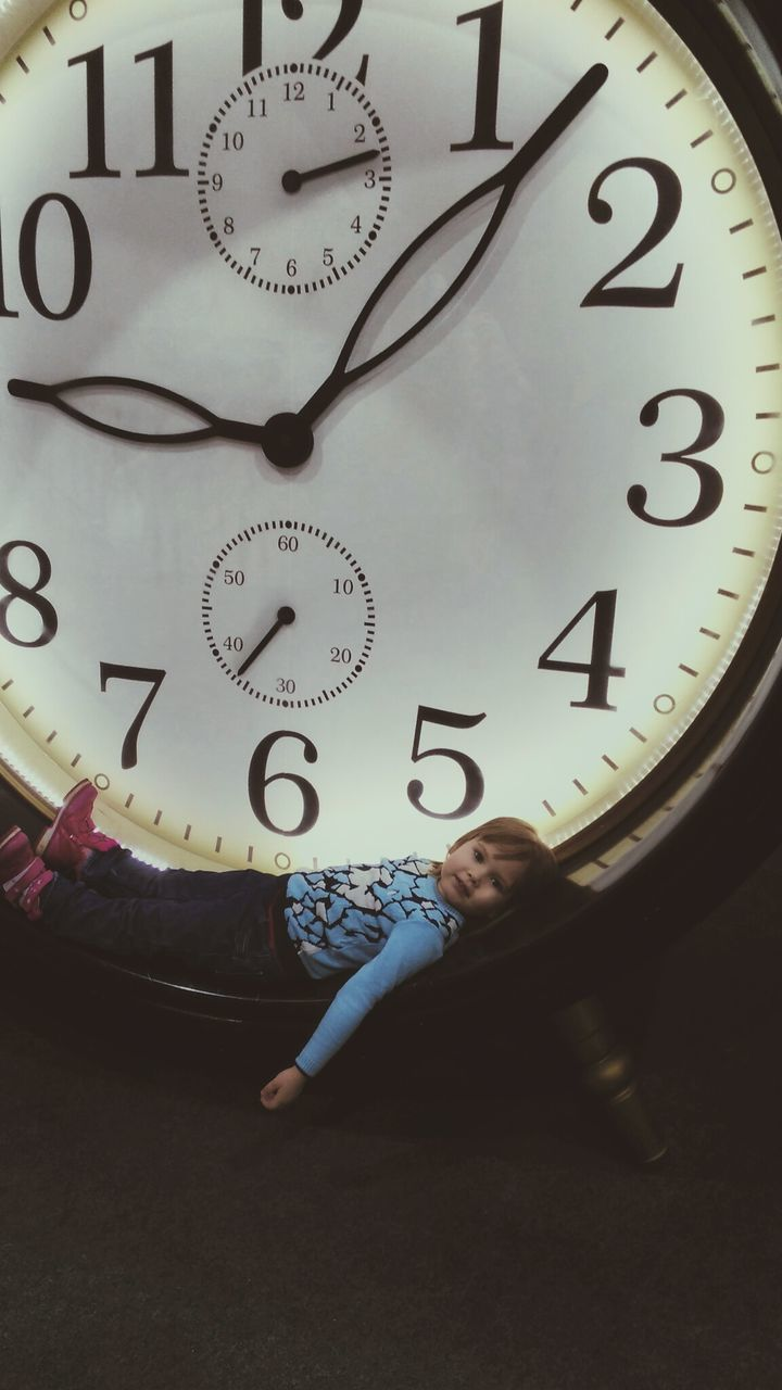 clock, time, clock face, indoors, one person, minute hand, full length, real people, hour hand, low section, close-up, day, roman numeral, people