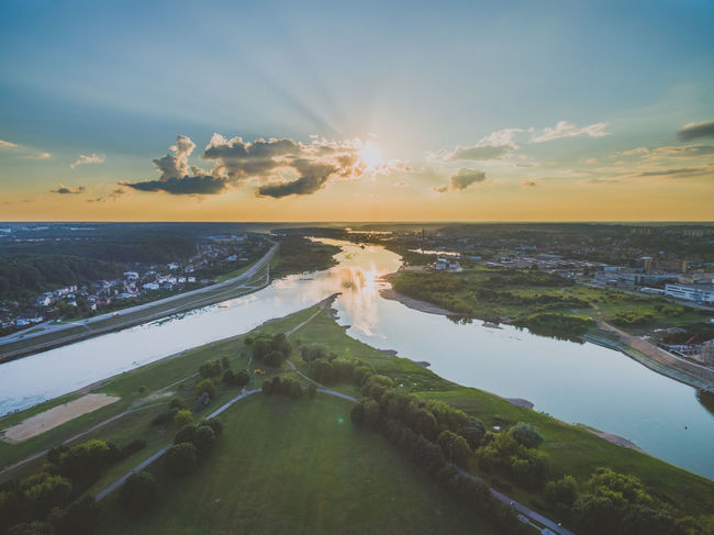 Aerial image of Kaunas city, Lithuania. Summer sunset time. Baltic Countries Clouds And Sky Europe Kaunas Landscape Nemunas Neris No People Outdoors River Sky Sunbeam Sunset