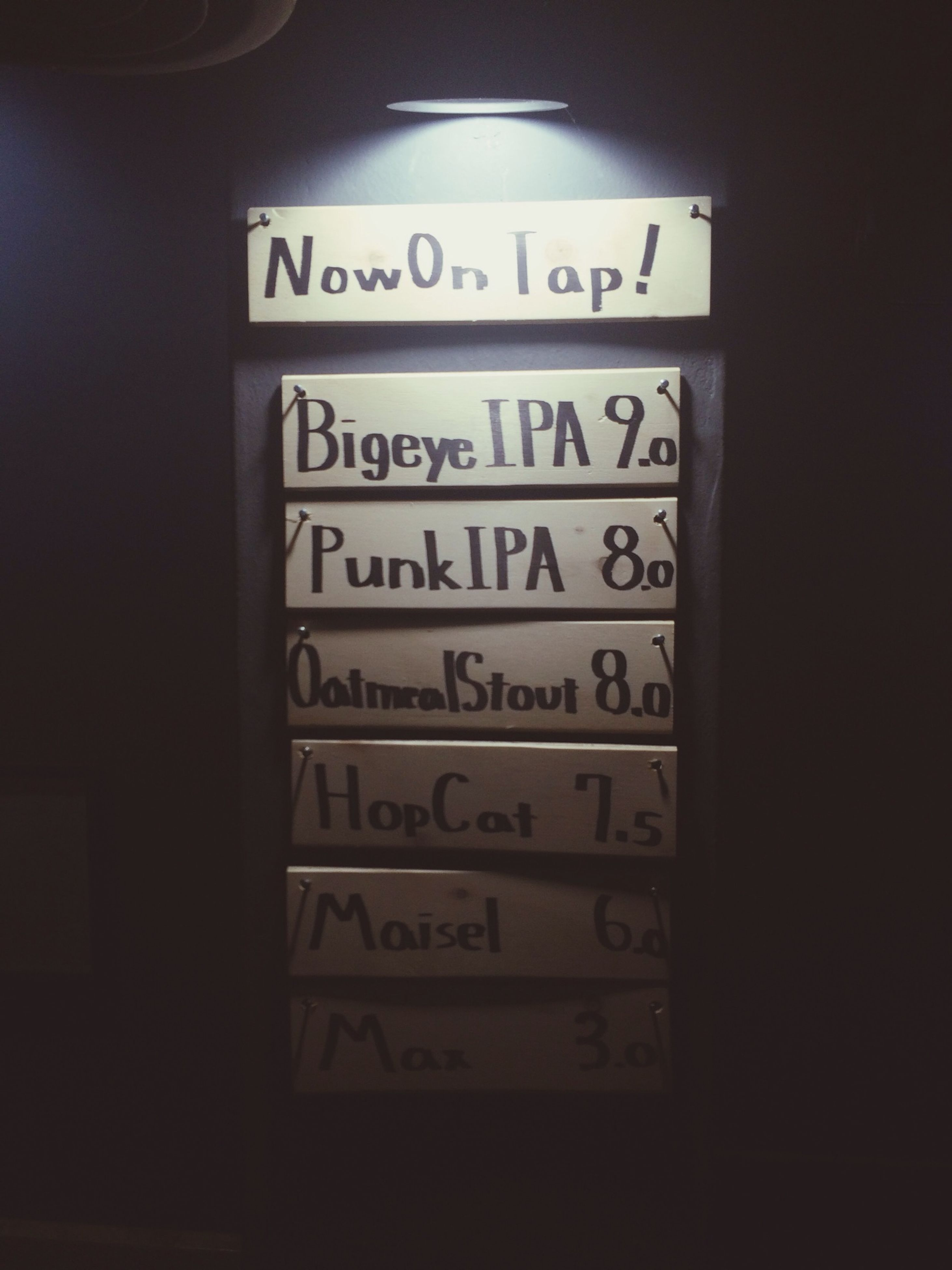indoors, text, communication, western script, number, close-up, technology, non-western script, capital letter, no people, wall - building feature, connection, information, illuminated, old-fashioned, information sign, wall, clock, time, copy space