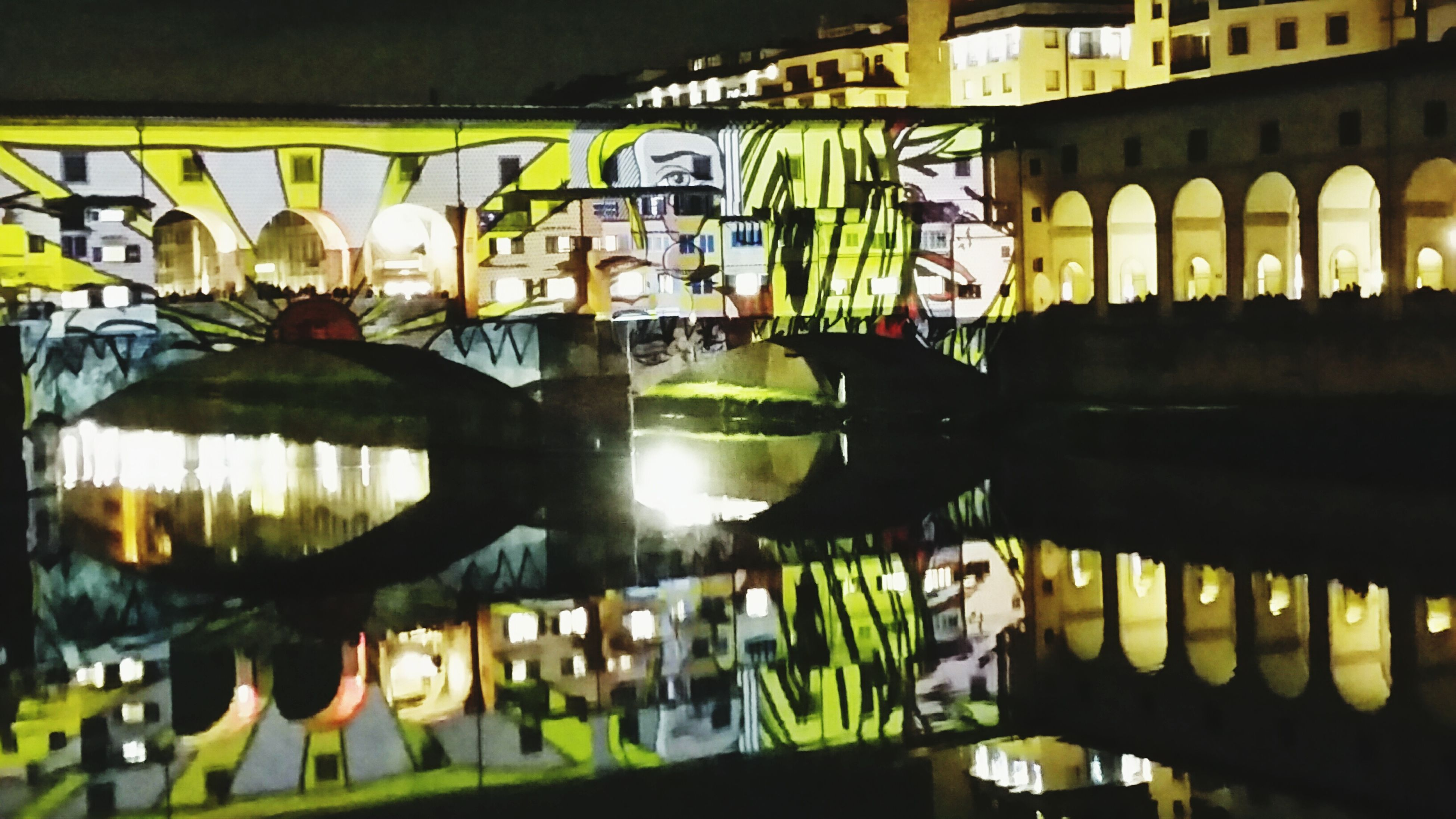 architecture, built structure, reflection, illuminated, arch, multi colored, in a row, water, building exterior, night, incidental people, indoors, lighting equipment, no people, decoration, pond, green color, yellow