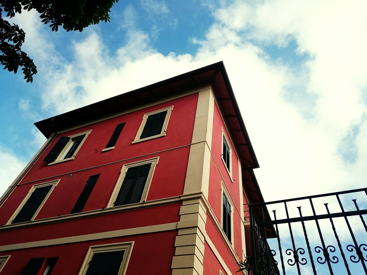 building exterior, sky, low angle view, built structure, architecture, cloud - sky, outdoors, day, window, no people, red, city, nature