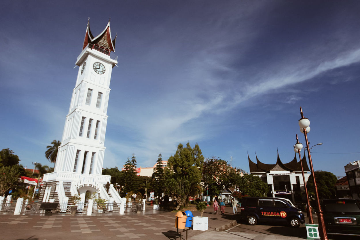 "Jam Gadang (literally ""Big Clock"") is a clocktower and major landmark of the city of Bukittinggi, West Sumatra, Indonesia. It is located in the centre of the city, near the main market, Pasar Atas, and is a tourist attraction. This clocktower has large clocks on each side and was given the name ""Jam Gadang"" (English: big clock). Big Clock Bukit Tinggi City Landmark Cityscapes Clock Clock Tower INDONESIA Jam Gadang Landmark"