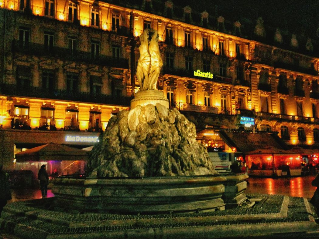 Sculpture Statue Night Illuminated Human Representation Building Exterior Architecture Outdoors City Built Structure No People Tranquility Tourism Travel Vacations Travel Destinations Montpellier Tourism My French Resolution Montpellier France🇫🇷 Place De La Comédie Montpellier By Night