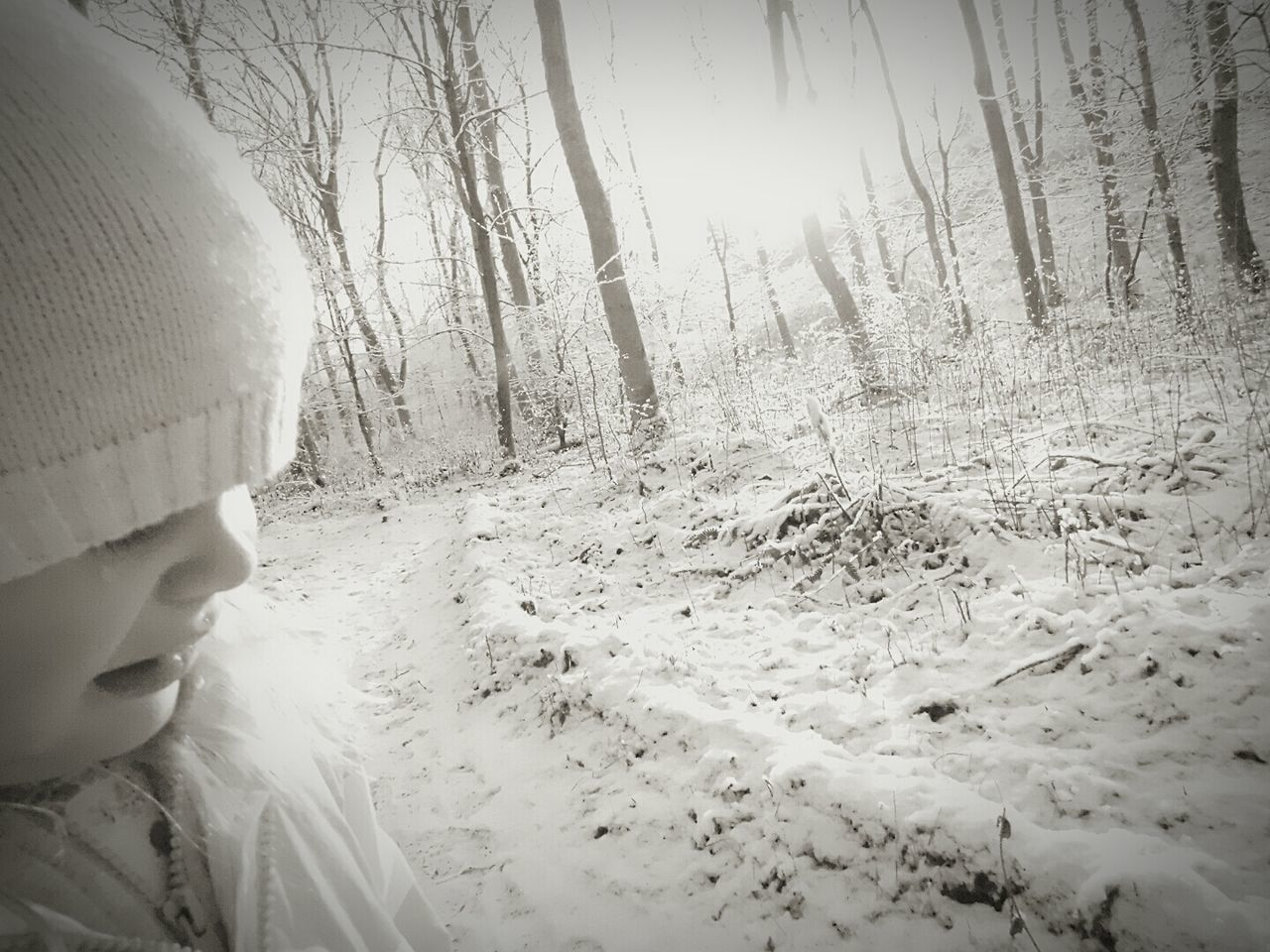 Close-Up Of Girl In Snow Covered Forest