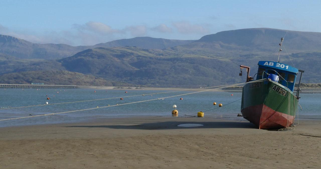 Beach Beached Boat Marooned Marooned Boat Mountain Mountain Range Outdoors Scenics Sea Sky Stranded Water EyeEmNewHere