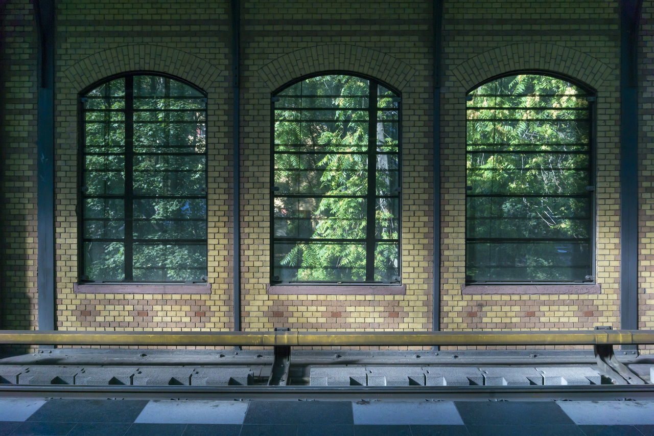 Trees Seen Through Windows By Old S-Bahn Station