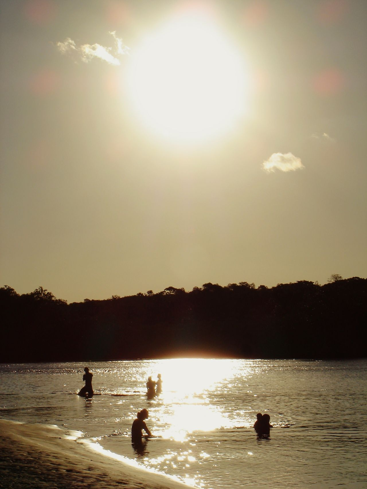 Sunlight Nature Silhouette Sunbeam Sun Beauty In Nature No People Outdoors Sunset River Shadownlight People Together Day Swimming