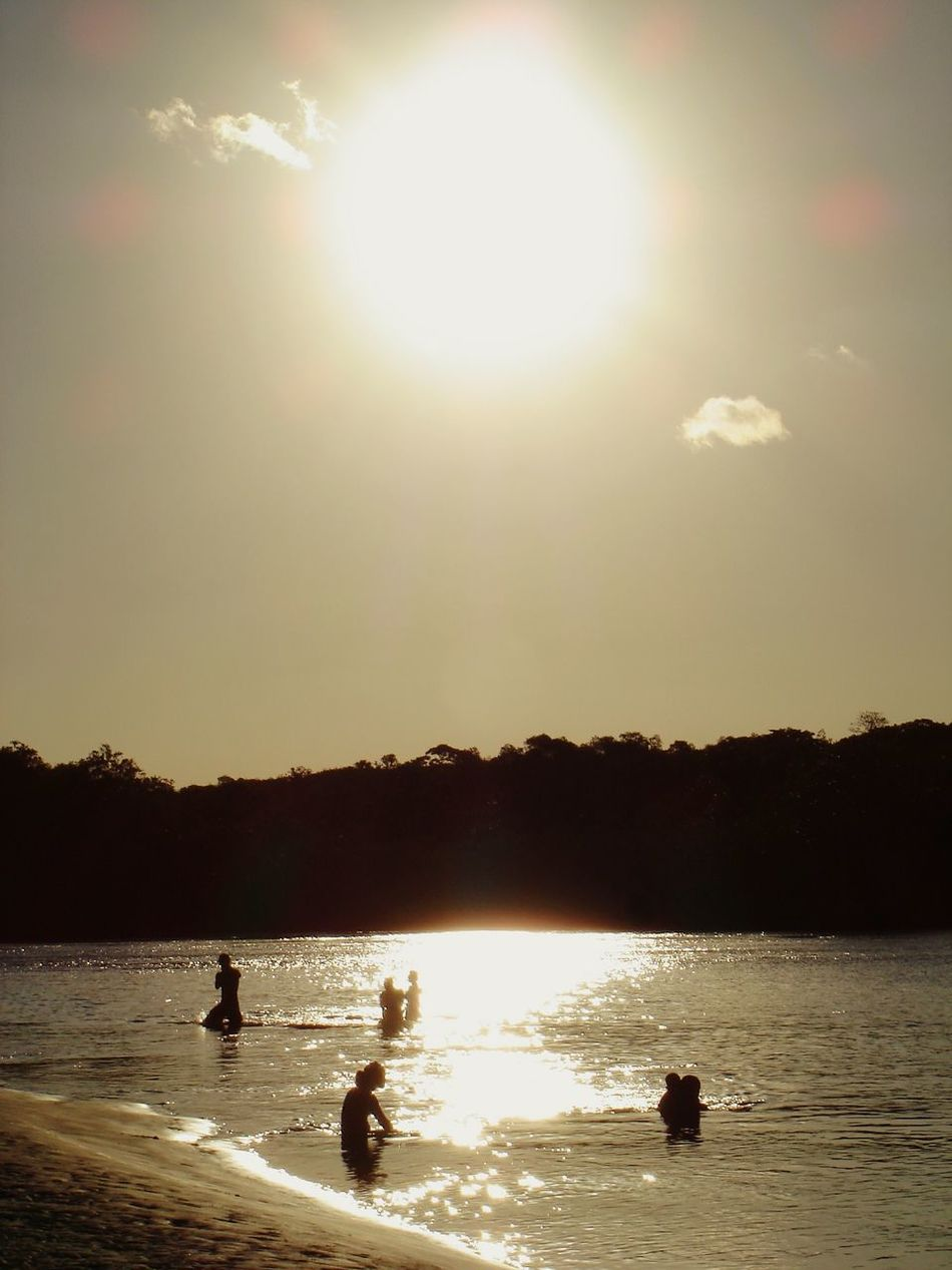 Sunlight Nature Silhouette Sunbeam Sun Beauty In Nature No People Outdoors EyeEm Nature Lover EyeEm Best Shots Reflection Sunset River Shadownlight People Together Day Swimming Travel Destinations Summertime