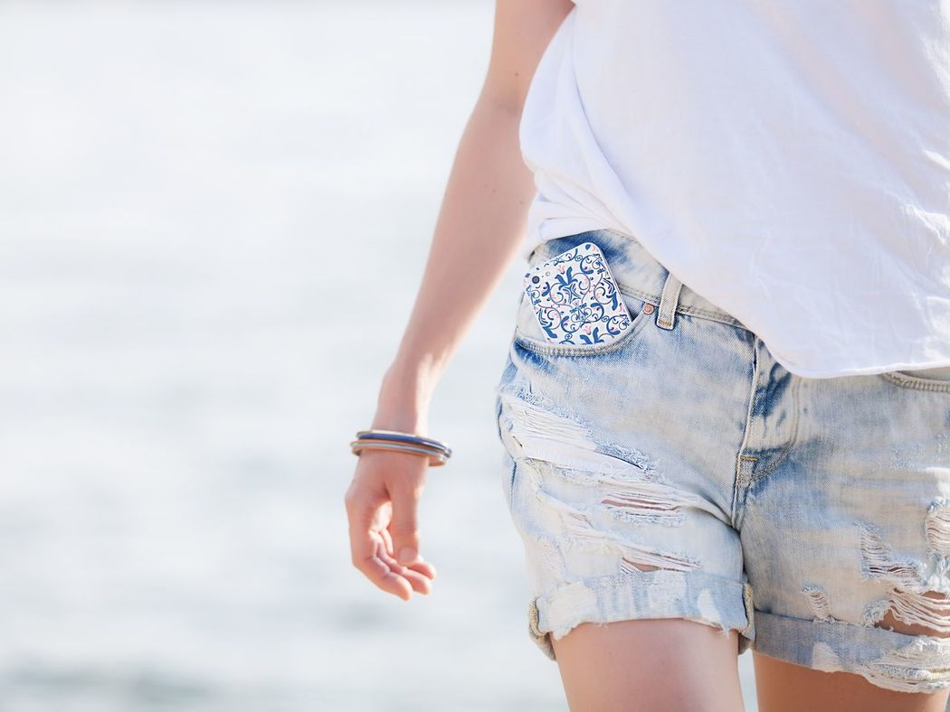 Girl in denim shorts and white T-shirt Hot Pants One Person Shorts Leisure Activity Real People Day Young Adult Outdoors Lifestyles Sea Vacations Beach Young Women Nature Sky Water People Adult Summer Summertime Look Summer Look Denim Denim Shorts White T-shirt EyeEmNewHere