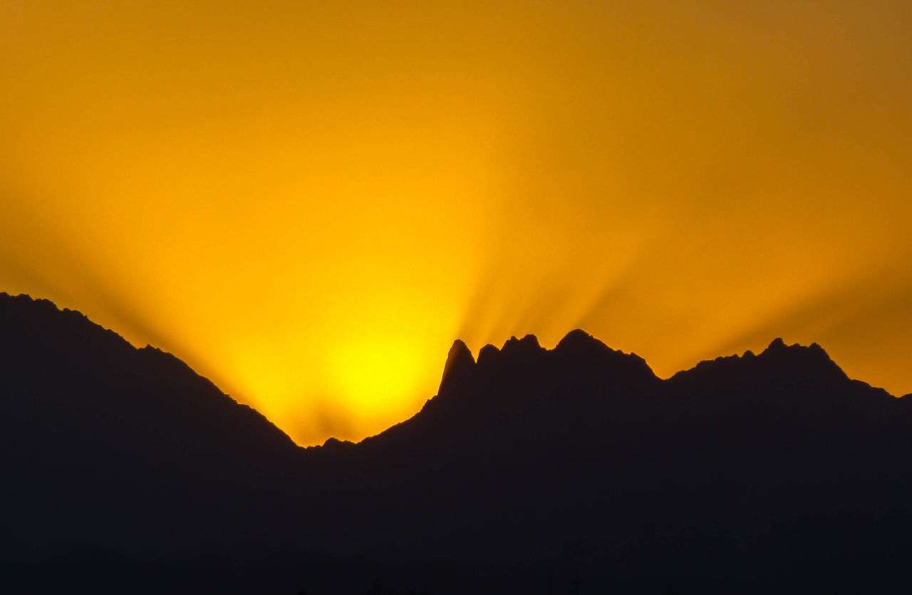 Beauty In Nature Dramatic Sky Mountain Mountain Range Nature No People Outdoors Scenics Silhouette Sky Sunset Tranquil Scene Tranquility Yellow