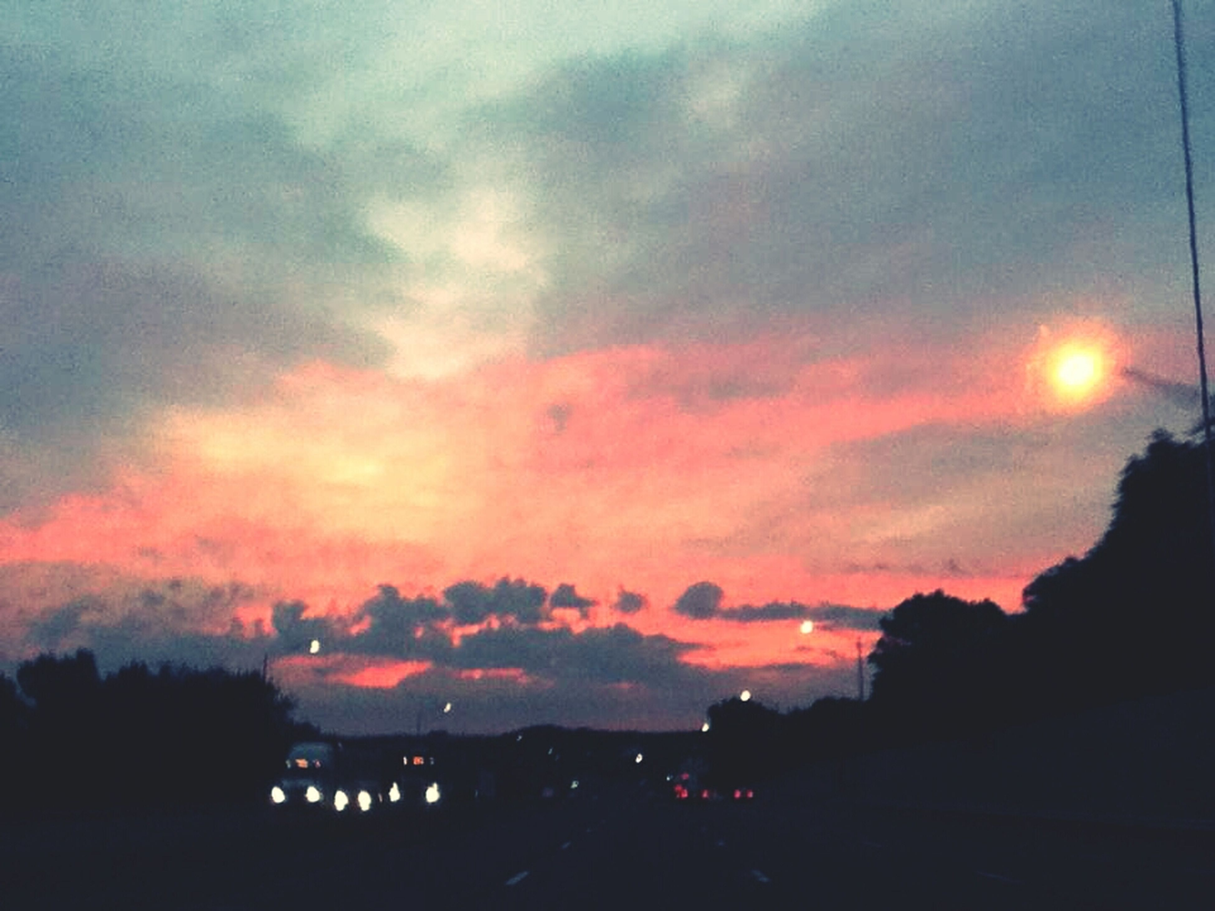 sunset, sky, silhouette, cloud - sky, beauty in nature, scenics, orange color, dramatic sky, nature, tranquil scene, tranquility, cloudy, cloud, dusk, building exterior, idyllic, weather, tree, moody sky, dark
